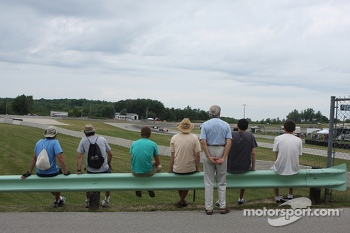 Fans watch formula cars go through Turn 8.