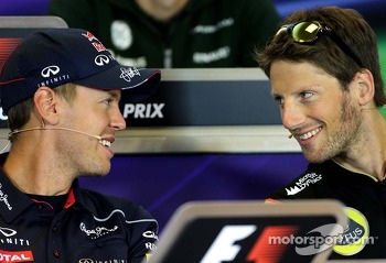 Sebastian Vettel, Red Bull Racing and Romain Grosjean, Lotus F1 Team at the press conference.