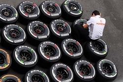 McLaren mechanic with Pirelli tyres.