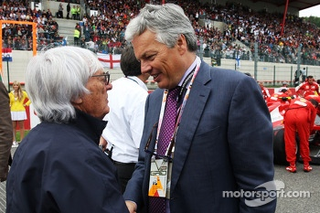 Bernie Ecclestone, CEO Formula One Group, with Didier Reynders, Politician on the grid