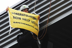 Greenpeace make a protest against race title sponsors Shell at the podium