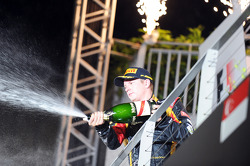 Kimi Raikkonen, Lotus F1 Team celebrates his third position on the podium