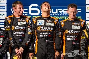 LMP2 podium: class winners John Martin, Roman Rusinov, Mike Conway