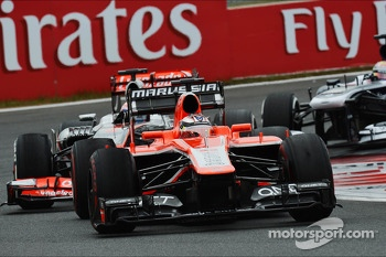 Jules Bianchi, Marussia F1 Team MR02 leads Jenson Button, McLaren MP4-28