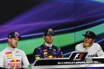 Qualifying top three in the FIA Press Conference: Sebastian Vettel, Red Bull Racing, second; Mark Webber, Red Bull Racing, pole position; Lewis Hamilton, Mercedes AMG F1, third