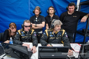 Nick Heidfeld, Nicolas Prost and Rebellion Racing team members watch qualifying