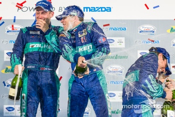 GT podium: champagne for Bryan Sellers, Wolf Henzler and Nick Tandy