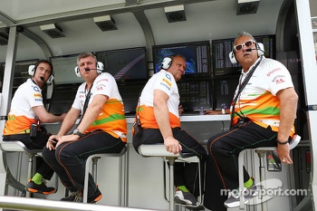 (L to R): Otmar Szafnauer, Sahara Force India F1 Chief Operating Officer with Robert Fernley, Sahara Force India F1 Team Deputy Team Principal and Dr. Vijay Mallya, Sahara Force India F1 Team Owner on the pit gantry