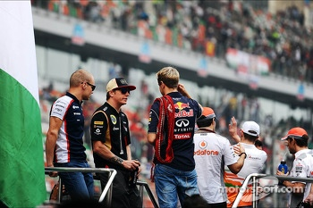 (L to R): Valtteri Bottas, Williams, Kimi Raikkonen, Lotus F1 Team and Sebastian Vettel, Red Bull Racing on the drivers parade