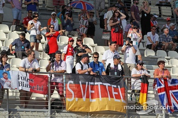 Fans and banners in the grandstand