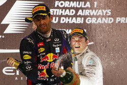 Nico Rosberg, Mercedes AMG F1 W04 celebrates his third position on the podium with second placed Mark Webber, Red Bull Racing