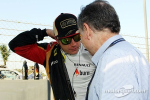 Kimi Raikkonen, Lotus F1 Team with Jean Todt, FIA President on the grid