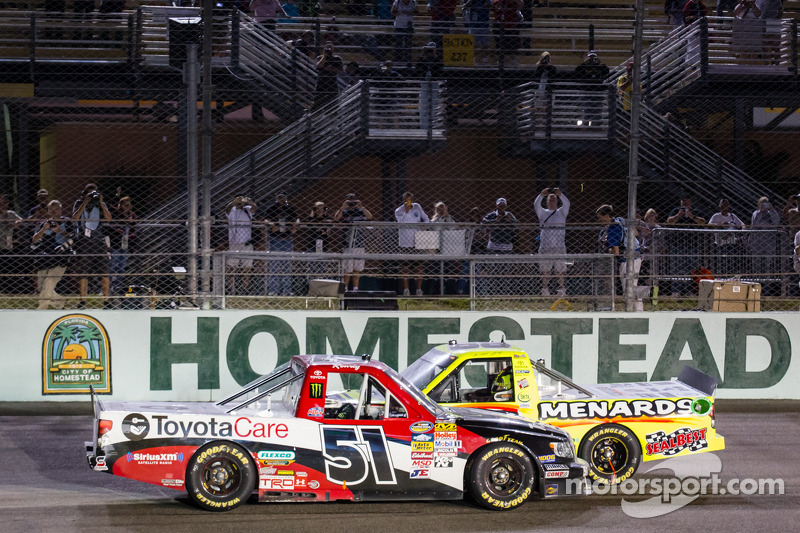 Race winner Kyle Busch and NASCAR Camping World Truck Series 2013 champion Matt Crafton celebrate