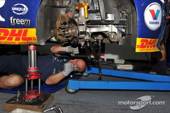 A mechanic is working on the car of Tom Coronel, BMW E90 320 TC, ROAL Motorsport