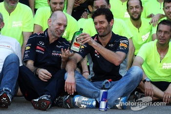 (L to R): Adrian Newey, Red Bull Racing Chief Technical Officer passes over the bottle of Jagermeister to Mark Webber, Red Bull Racing at the team celebration