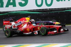 Fernando Alonso, Ferrari F138 passes Sebastian Vettel, Red Bull Racing RB9