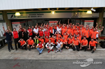 (L to R): Rodolfo Gonzalez, Marussia F1 Team Reserve Driver; Max Chilton, Marussia F1 Team and Jules Bianchi, Marussia F1 Team celebrate tenth position in the Constructors Championship with the team