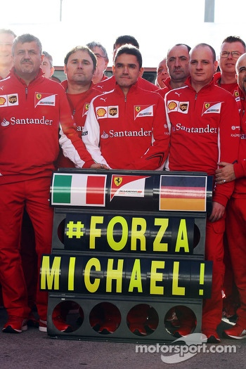 The Ferrari team show their support for Michael Schumacher