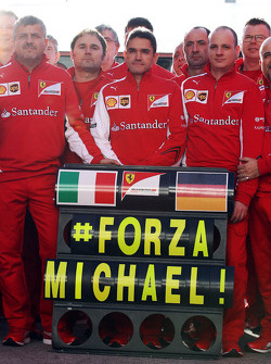 The Ferrari team show their support for Michael Schumacher
