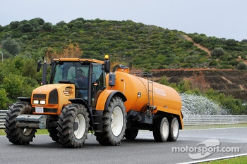 The sprinkler tractor wets the track as the day is declared the official wet weather day of Pirelli tyre testing