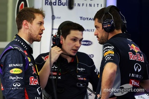 (L to R): Sebastian Vettel, Red Bull Racing with Tim Malyon, Red Bull Racing Performance Engineer and Guillaume Rocquelin, Red Bull Racing Race Engineer