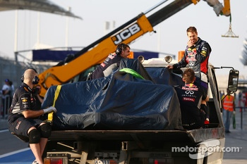 Sebastian Vettel, and his Red Bull Racing RB10 is recovered back to the pits on the back of a truck