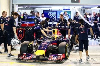 Sebastian Vettel, Red Bull Racing RB10 is pushed back in to his pits garage after being knocked out in Q2