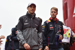 Jenson Button, McLaren and Sebastian Vettel, Red Bull Racing on the drivers parade.