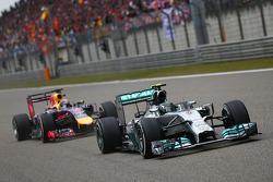 Nico Rosberg, Mercedes AMG F1 W05 leads Sebastian Vettel, Red Bull Racing RB10.