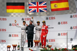 The podium Nico Rosberg, Mercedes AMG F1, second; Ron Meadows, Mercedes GP Team Manager; Lewis Hamilton, Mercedes AMG F1, race winner; Fernando Alonso, Ferrari, third