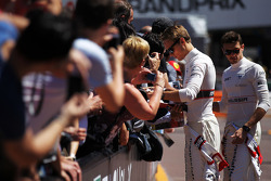 Max Chilton, Marussia F1 Team and Jules Bianchi, Marussia F1 Team sign autographs for the fans