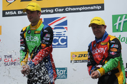 eBay Motors Duo Colin Turkington and Rob Collard spray champagne on the podium