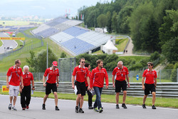 The Marussia F1 Team walk the circuit