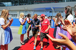F1: (L to R): Sebastian Vettel, Red Bull Racing with Kimi Raikkonen, Ferrari on the drivers parade