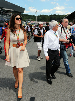 Bernie Ecclestone, with his wife Fabiana Flosi, on the grid