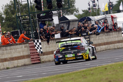 Colin Turkington, eBay Motors crosses the line to take victory in round 13