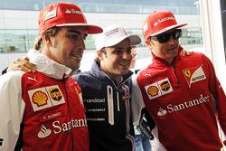 Felipe Massa, Williams, celebrates his 200th GP with Fernando Alonso, Ferrari, and Kimi Raikkonen, Ferrari