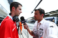 Alexander Rossi, Marussia F1 Team Reserve Driver with Will Buxton, NBS Sports Network TV Presenter