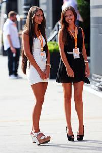 Two young women in the paddock