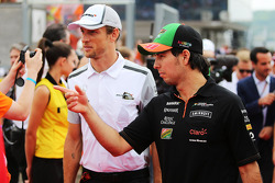 Sergio Perez, Sahara Force India F1 and Jenson Button, McLaren on the drivers parade.