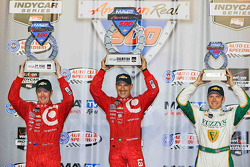 Podium: race winner Tony Kanaan, second place Scott Dixon, third place Ed Carpenter