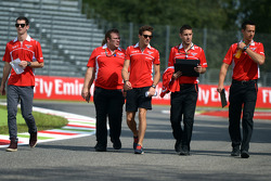 Jules Bianchi, Marussia F1 Team and Alexander Rossi, Marussia F1 Team Reserve Driver, walk the circuit