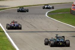 Sebastian Vettel, Red Bull Racing RB10 leads Jenson Button, McLaren MP4-29