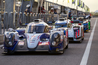LMP1 cars line-up to resume qualifying following a red flag