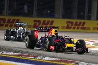 Sebastian Vettel, Red Bull Racing leads Lewis Hamilton, Mercedes AMG F1 Team