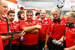 Damon Hill, Sky Sports Presenter and Johnny Herbert, Sky Sports F1 Presenter work with the Marussia F1 Team Mechanics