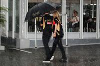 Romain Grosjean, Lotus F1 Team in a wet and rainy paddock