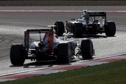 Kevin Magnussen, McLaren MP4-29 leads Sebastian Vettel, Red Bull Racing RB10