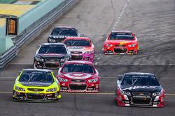 Paul Menard, Richard Childress Racing Chevrolet, Kyle Larson, Ganassi Racing Chevrolet and Kurt Busch, Stewart-Haas Racing Chevrolet head back to track