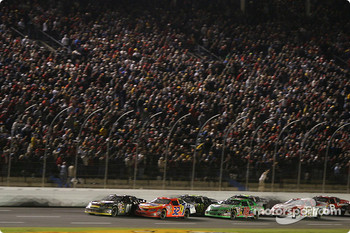 Joe Nemechek leads the field to a restart